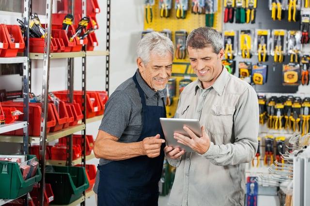Sales rep at retail customer store placing order using LinkGreen
